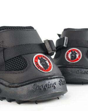 Two Black All Terrain Ultra Jogging Shoe sitting side by side